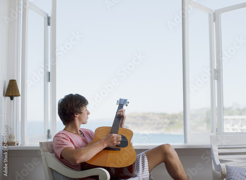 Man strumming guitar