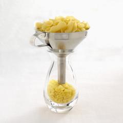 farfalline pasta in a funnel