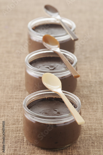 small pots of dark chocolate cream desserts