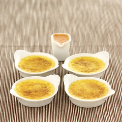 vanilla crème brulée with strawberry puree