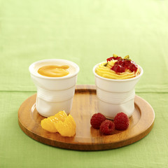 aniseed cream dessert with raspberries ,vanilla custard with orange puree