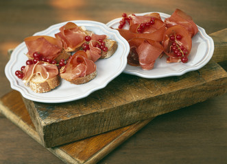 raw ham and redcurrant open sandwiches