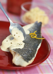 steam-cooked bass fillet with creamy aniseed sauce