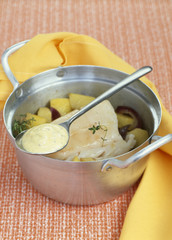 casserole dish of cod and potatoes with mustard sauce