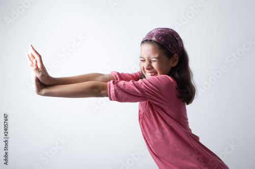 Young girl pushing imaginary wall