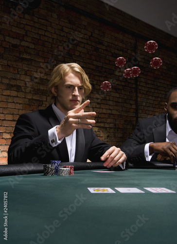 Man throwing poker chips in casino