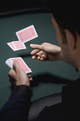 Dealer dealing cards in casino