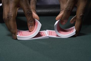 Dealer shuffling cards in casino