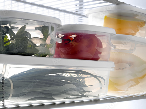 tupperwares full of fresh products in the refrigerator