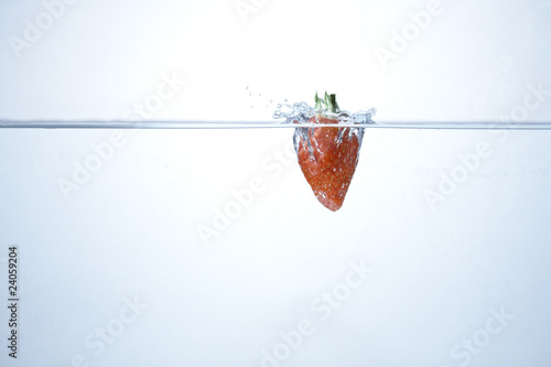 strawberry falling in the water