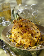 leg of lamb covered with sliced pineapple and cloves