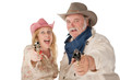 Couple in western wear pointing pistols