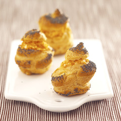 pastry puffs filled with carrot mousse