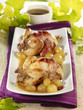 quails cooked in a casserole dish with grapes and cognac