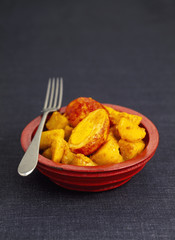 hard boiled tandoori egg with potato and curry salad
