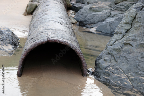 rusty overflow seashore pipe