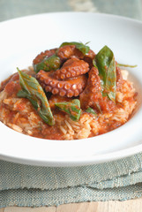 risotto and octopus fricassée with tomatoes and fresh basil
