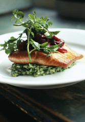 pan-fried salmon ,herb risotto ,cress and beetroot