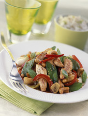sliced grilled chicken with vegetables and cashew nuts