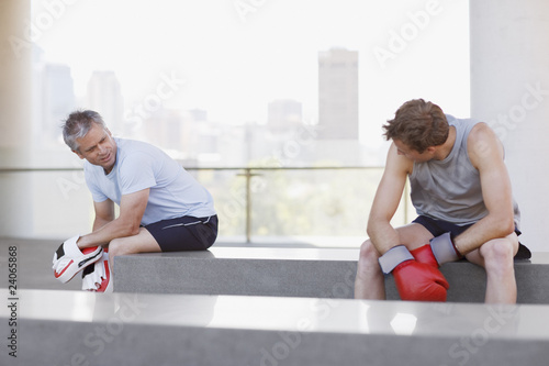 Boxer and coach resting after training