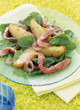 spinach and potato salad with red onions and ham