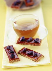 almond and hazelnut croquants with caramel and violets and a cup of tea
