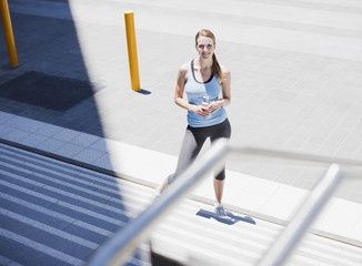 Woman stopping on stairs after exercise