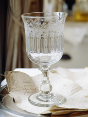 crystal glass on wedding papers