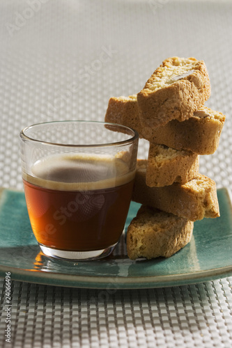 cup of tea with pile of almond croquets