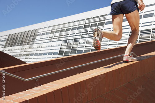 Man running up brick stair railing