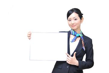 asian girl has blank white board