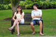 Young Asian Couple in Love arguing on a bench
