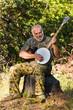 Older Man Playing the Banjo Outdoors