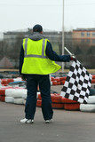 Worker with flag on go-cart racing