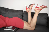 Beautiful woman  legs and heels sitting relaxing
