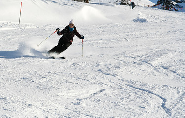 Woman is skiing at a ski resort