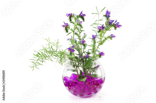 Wild flowers in a vase with colorful crystal flowers