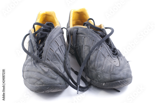 two old black soccer shoes