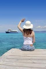 Woman tourist illetas Formentera goodbye