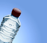 Purified spring water in the bottle over clear blue background poster