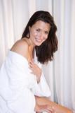 Beautiful brunette woman wearing bathrobe
