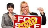 Female with Blonde Woman Holding Keys and Sold For Sale Sign