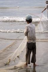 Young vietnamese fisherman