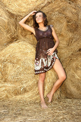 Young beautiful attractive woman in a haystack