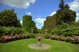 English garden with rose border and sundial poster