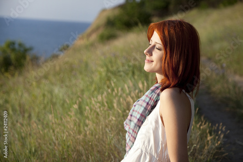 Girl at hill in sunrise.