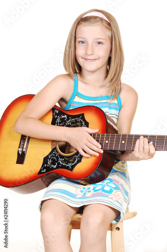Young blond girl with guitar.
