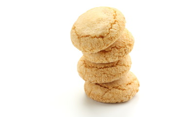 Stack of traditional Italian biscuits on white background