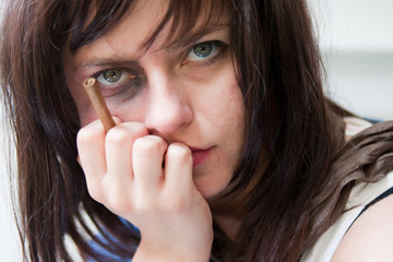 Upset young woman with a bruised black-eye