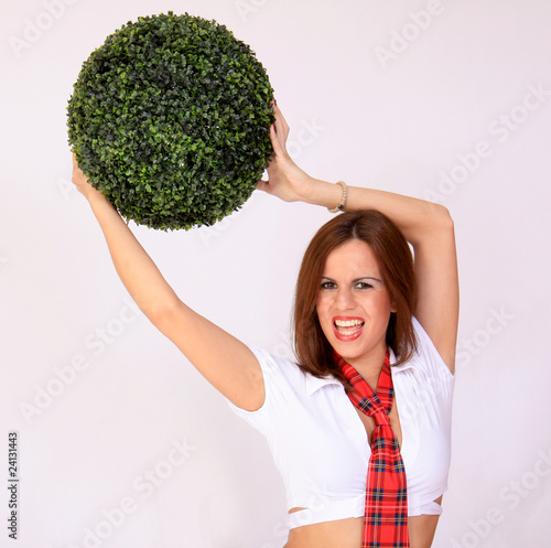 Young schoolgirl holding a green ball
